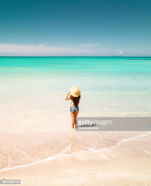 woman standing on the caribbean beach