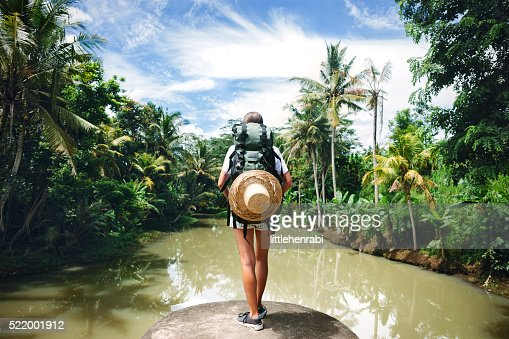 Woman standing on the edge and looking far away : Stock Photo