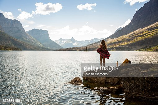A woman standing on the shore of St. Mary lake