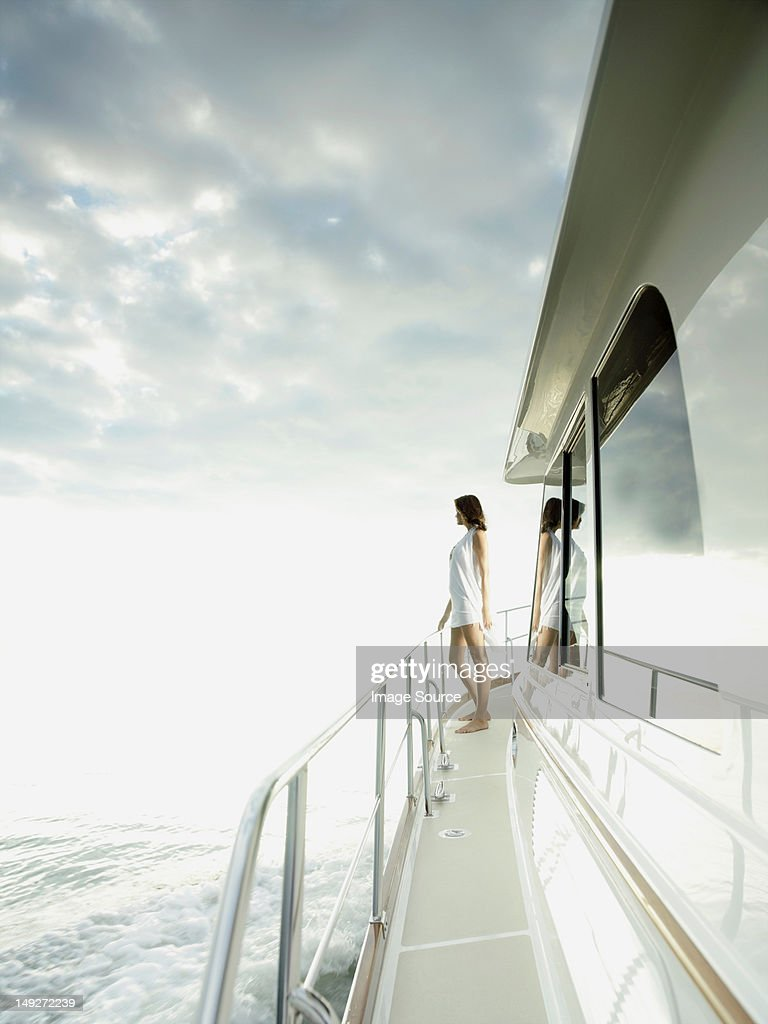 Woman standing on yacht
