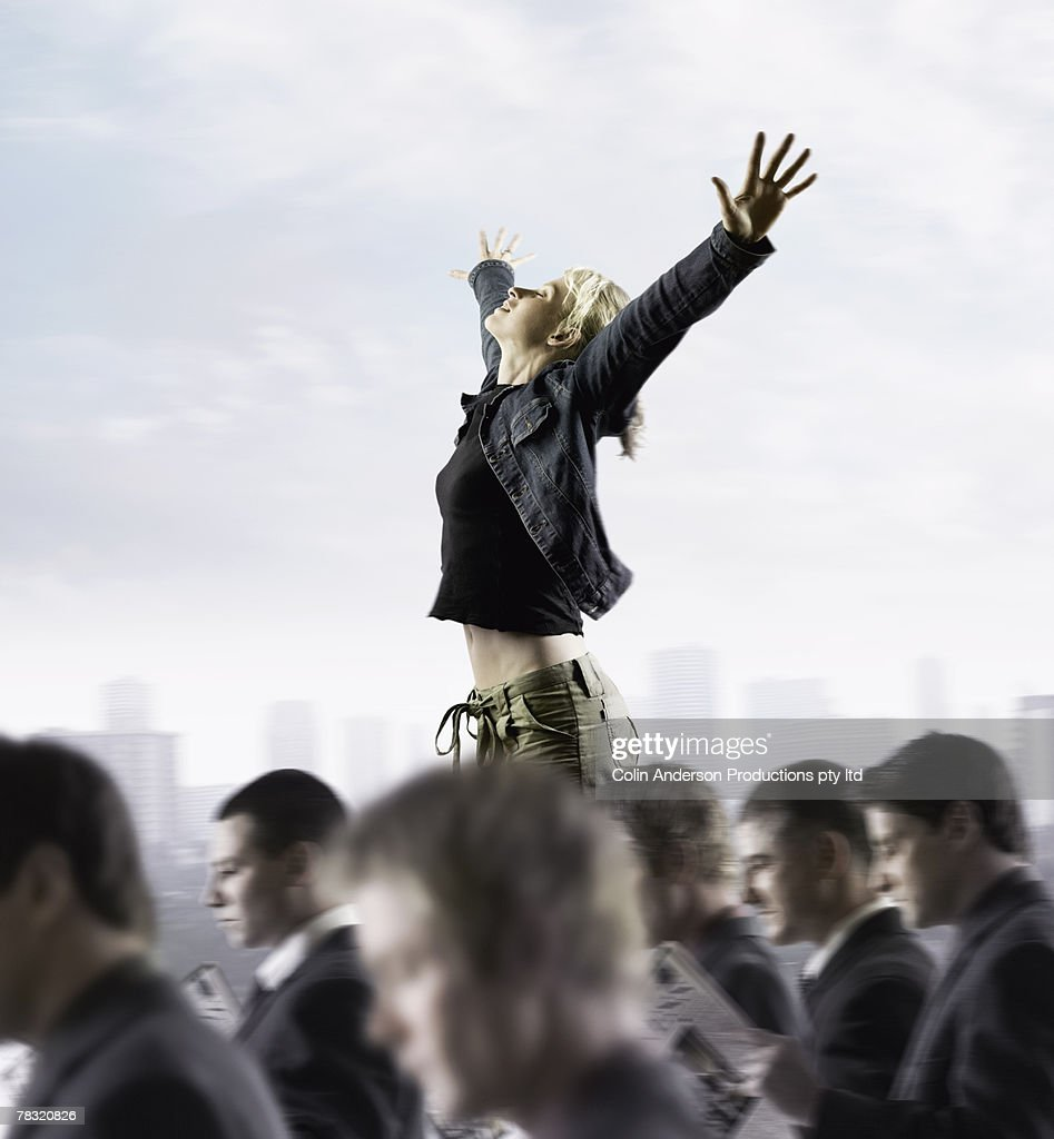 Woman standing out from crowd : Stock Photo