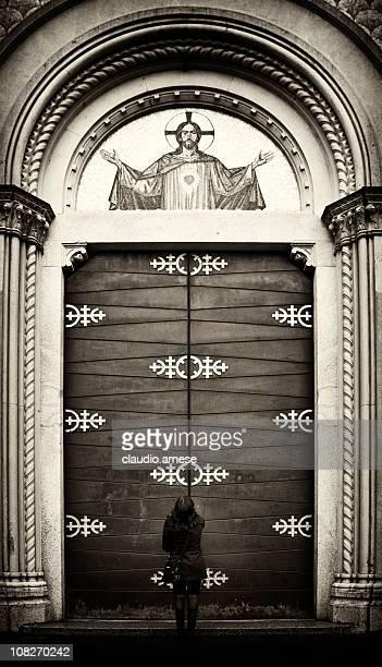 Woman Standing Outside Church Door