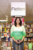 Woman standing under a fiction sign