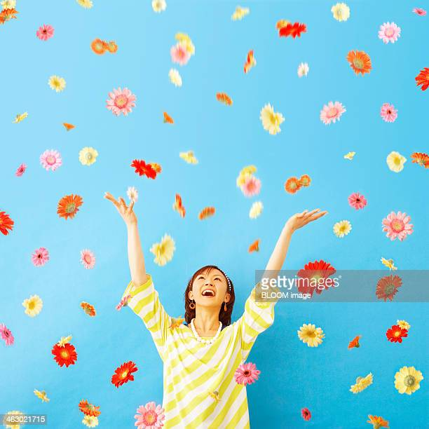 Woman Standing Under Shower Of Flower