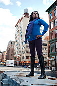 woman standing up high in city