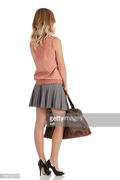 Woman standing with a hand bag