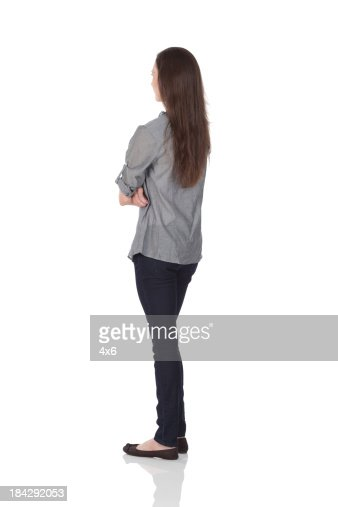 Woman Standing With Arms Crossed Stock Photo | Getty Images