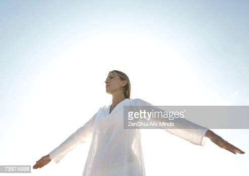 Woman standing with arms out