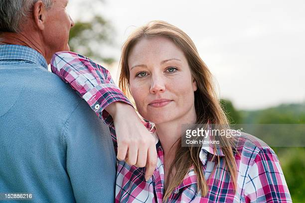 Woman standing with father outdoors