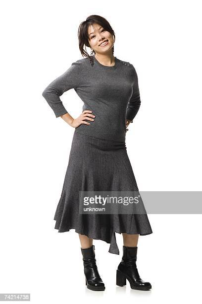 Woman standing with hands on hips smiling