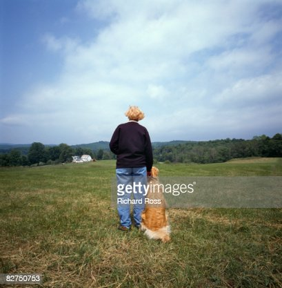 woman standing with her dog : Stock Photo