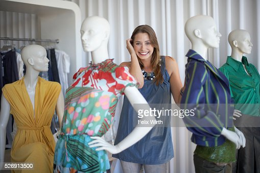 Woman standing with mannequins : Stock Photo