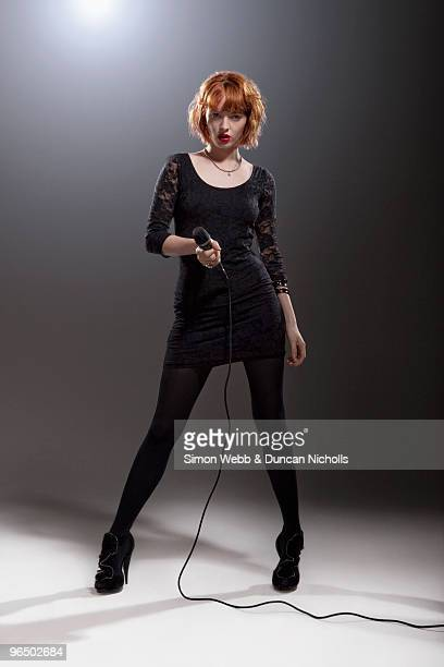 Woman standing with microphone