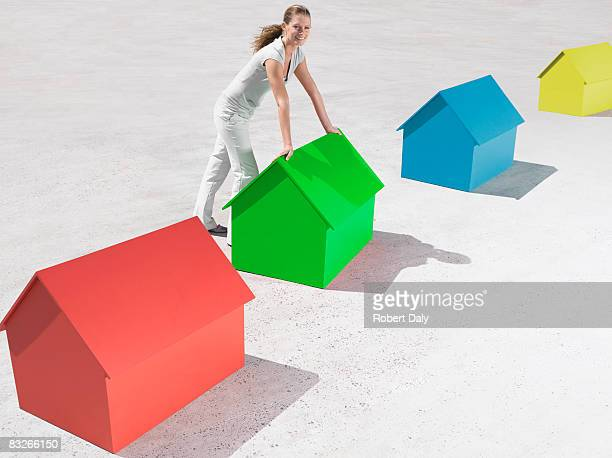 Woman standing with small model houses
