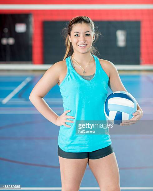 Woman Standing with Volleyball