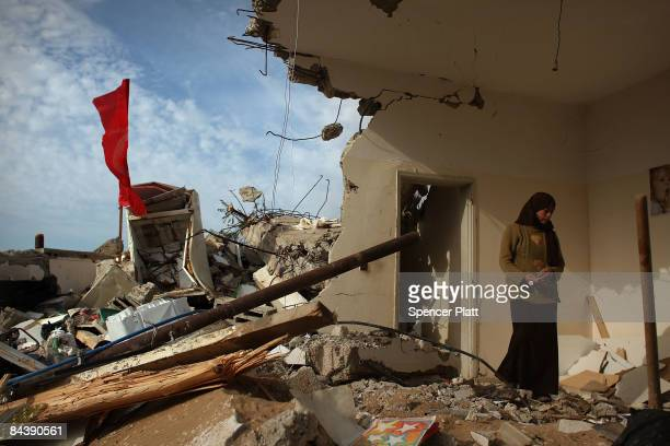 A woman stands among the remains of her home in a destroyed neighborhood January 21 2009 in a suburb of Gaza City Gaza Strip Over 70 percent of Gaza...