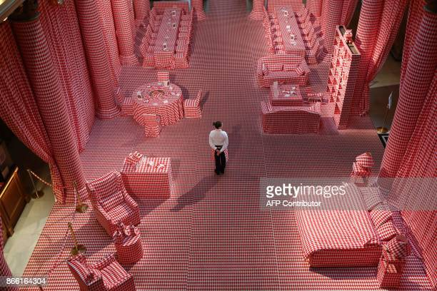 A woman stands at the entrance of the Casino of MonteCarlo decorated for the 'Let's fall in diamonds' exhibition by Belgian artist and designer...