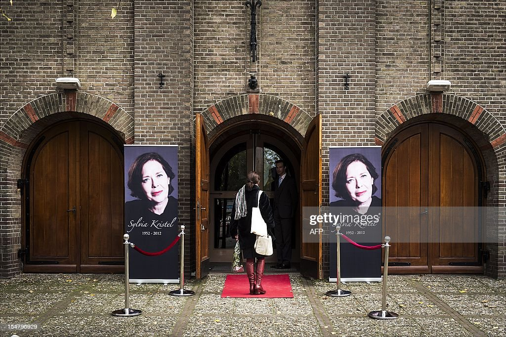 A woman stands at the entrance of the Sint-Aloysius church in Utrecht where the private memorial service for Dutch actress Sylvia Kristel was being held, on October 26, 2012. Dutch actress Sylvia Kristel, who starred in the cult erotic 'Emmanuelle' films, was laid to rest after a 'stylish and beautiful' ceremony in her birthplace Utrecht, her agency said. The actress, whose iconic role symbolised the sexual revolution of the 1970s, died on October 18 aged 60 after a battle with cancer. AFP PHOTO / ANP / ERIK VAN 'T