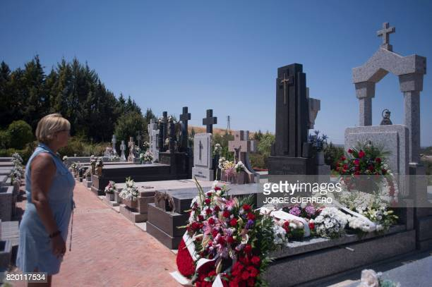 A woman stands before the grave of former head of Spanish bank Caja Madrid Miguel Blesa at the Virgen de Linarejos cementery in Linares on July 21...