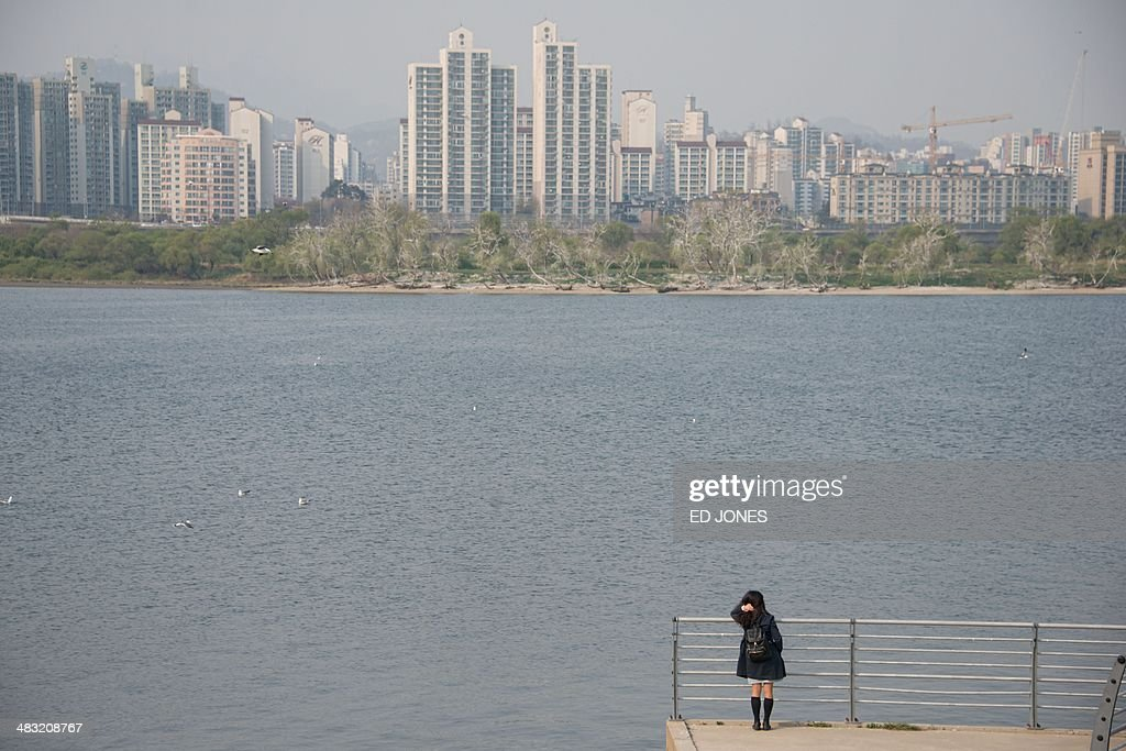 A woman stands before the Han river in Seoul on April 7 2014 Spring time in South Korea typically lasts from April to June and features mild...