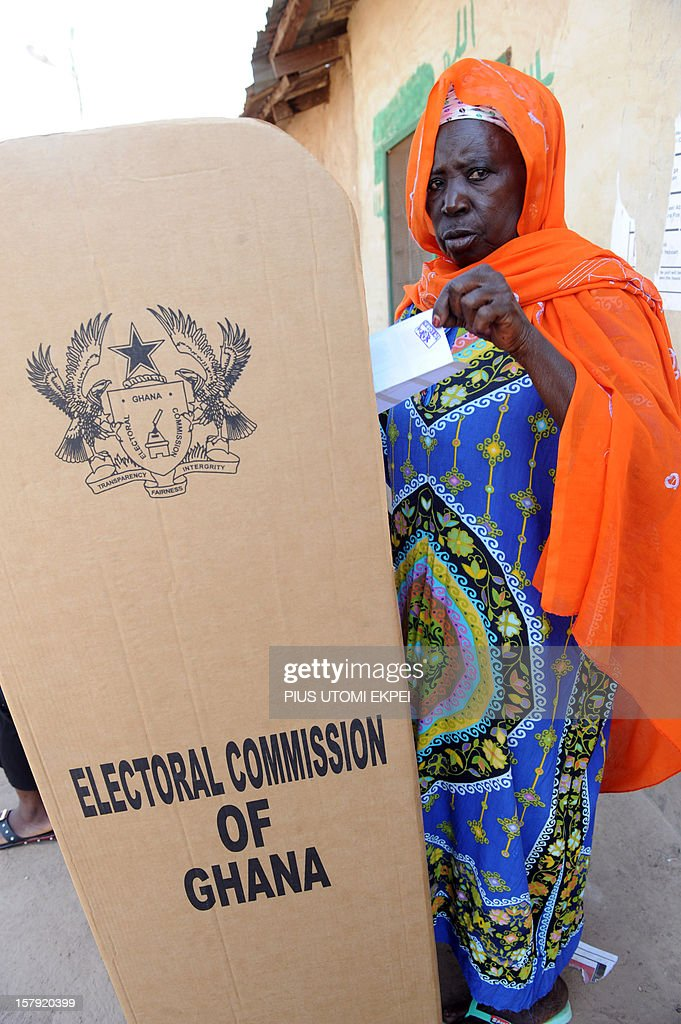 A woman stands behind a voting booth at Bole polling station in the northern region on December 7, 2012. Ghana voted in a high-stakes presidential election which is expected to be close, with the emerging country seeking to live up to its promise as a beacon of democracy in turbulent West Africa.