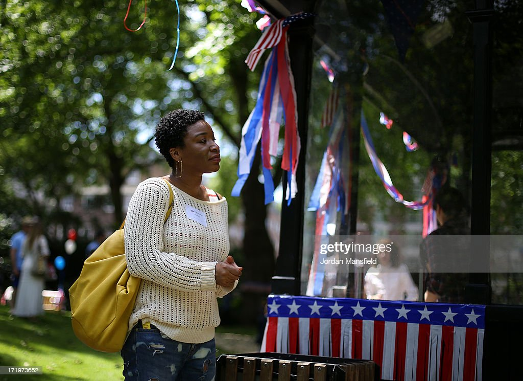 A woman stands by some USA Flag bunting on June 30, 2013 in London, England. American Democrats living in London gather in Portman Square for the largest Independence Day celebration in London ahead of the American federal holiday on the 4th July which commemorates the Declaration of Independence on July 4, 1776 which declared them the USA free from the Kingdom of Great Britain.