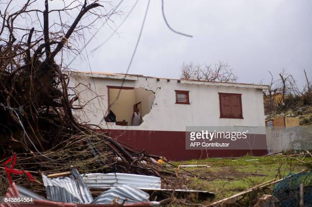 A woman stands in a damaged house on September 7 on the French Carribean island of SaintMartin after the passage of Hurricane Irma France the...