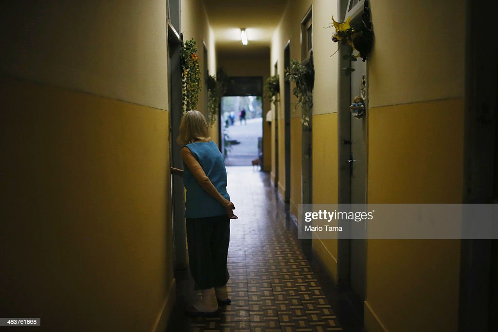 A woman stands in a hallway in Hospital Curupaiti part of a former leprosy colony on June 10 2015 in the Jacarepagua neighborhood of Rio de Janeiro...