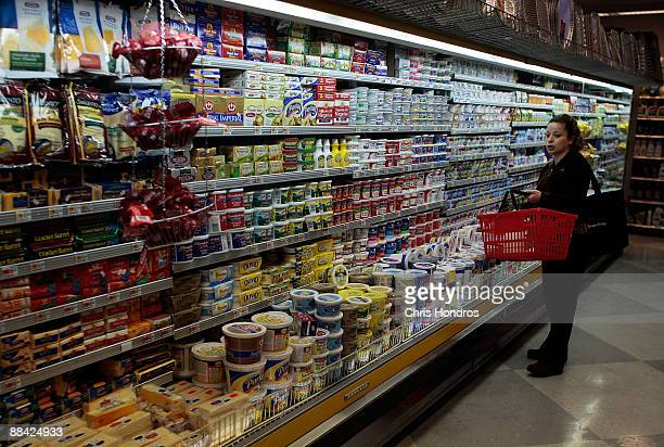 A woman stands in a supermarket aisle June 11 2009 in New York City US retail sales rose during the month of May according to economists though much...