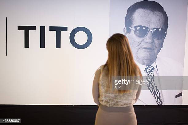KAVCIC A woman stands in front of a photo portrait of former Yugoslavia's iconic communist leader Josip Broz 'Tito' on November 16 2013 in Ljubljana...