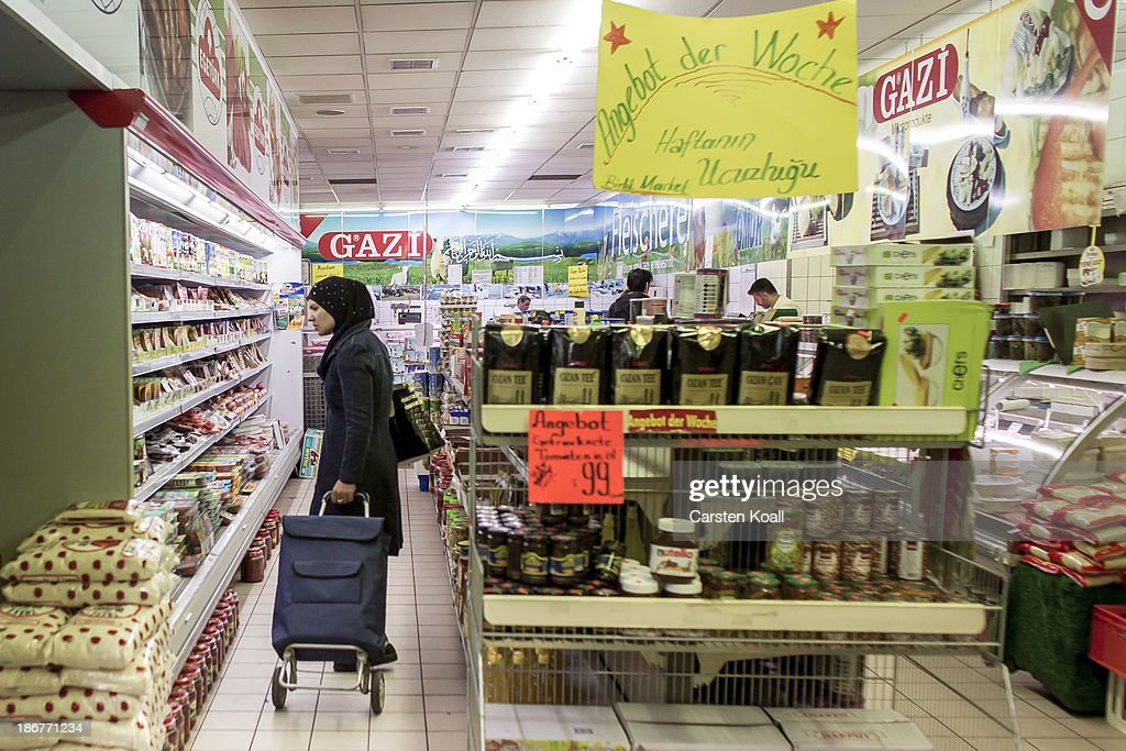 A woman stands in front of a shelf stacked full of goods in the Turkish supermarket Marketler at Karl-Marx-Strasse in Neukoelln district on November 02, 2013 in Berlin, Germany. According to recently published statistics, 7.2 million foreigners were living in Germany by the end of 2012, which is the highest number ever recorded. Of those 80% are from countries in the European Union, while the rest come primarily from Turkey, Russia, the former Soviet states and Arab countries.
