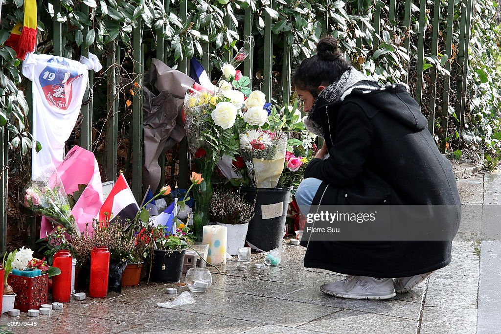 A woman stands in front of the tributes to the victims of the Paris Attacks across the road from of 'Bataclan Cafe'on February 13, 2016 in Paris, France. People continue to leave tributes to victims three months after the Paris terrorist attacks.