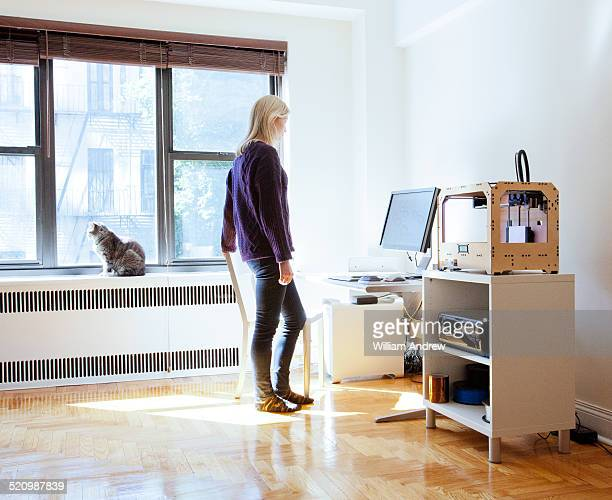 Woman stands in home design studio