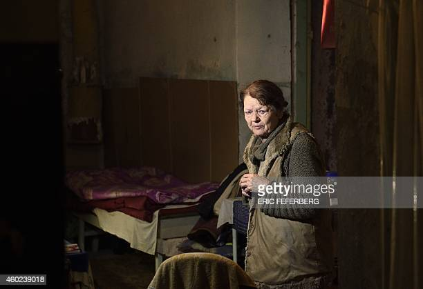 A woman stands in the cellar of her building used as a shelter cries in Kievskiy district witch is often sheld in the eastern Ukrain city of Donetsk...