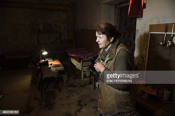 A woman stands in the cellar of her building used as a shelter in Kievskiy district witch is often sheld in the eastern Ukrain city of Donetsk...