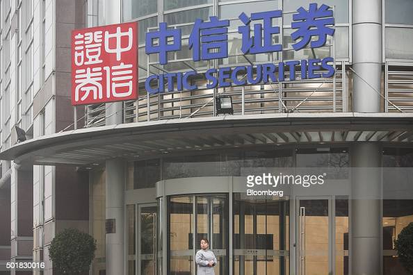 A woman stands near the entrance to the Citic Securities Co headquarters in Beijing China on Tuesday Dec 1 2015 The fall from grace for China's...