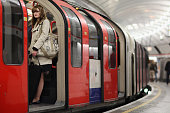 A woman stands on a train at an Underground station on March 5 2012 in London England London's underground rail system commonly called the tube is...