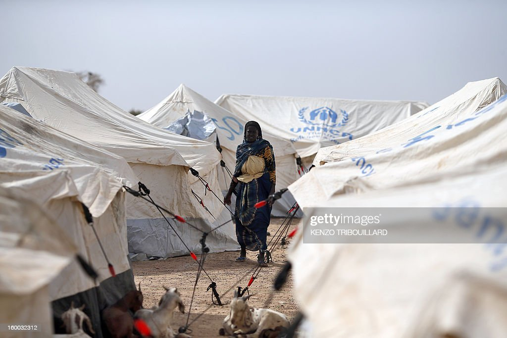 A woman stands on January 24, 2013 among tents in a refugee camp set in Menteao near the Malian border. The conflict in Mali has caused nearly 150,000 people to flee the country, while about another 230,000 are internally displaced, the UN humanitarian agency said on January 15, 2013. According to OCHA, the UN High Commissioner for Refugees has registered 144,500 refugees in neighbouring countries -- 54,100 in Mauritania, 50,000 in Niger, 38,800 in Burkina Faso and 1,500 in Algeria.