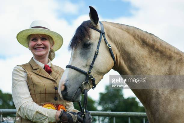 A woman stands with her horse after competing during the 194th Sedgefield Show on August 12 2017 in Sedgefield England The annual show is held on the...