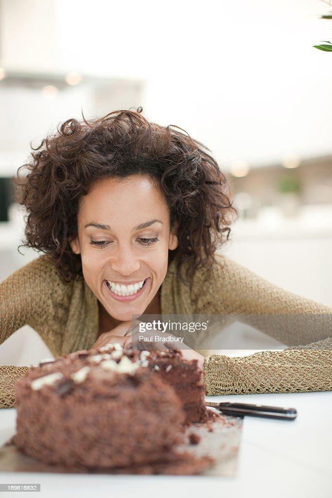 Woman staring at chocolate cake : Stock Photo