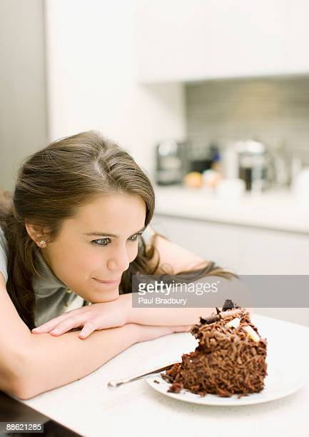 Woman staring at chocolate cake