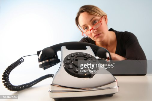 woman staring at phone : Stock Photo