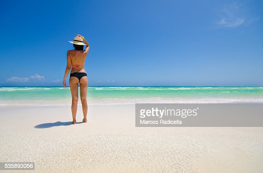 Woman staring at the sea, Cayo Coco, Cuba. : Stock Photo
