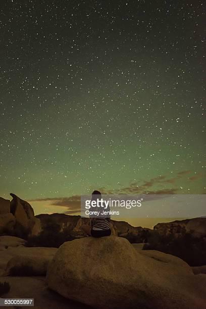 Woman, starry night, Joshua Tree National Park, California, US
