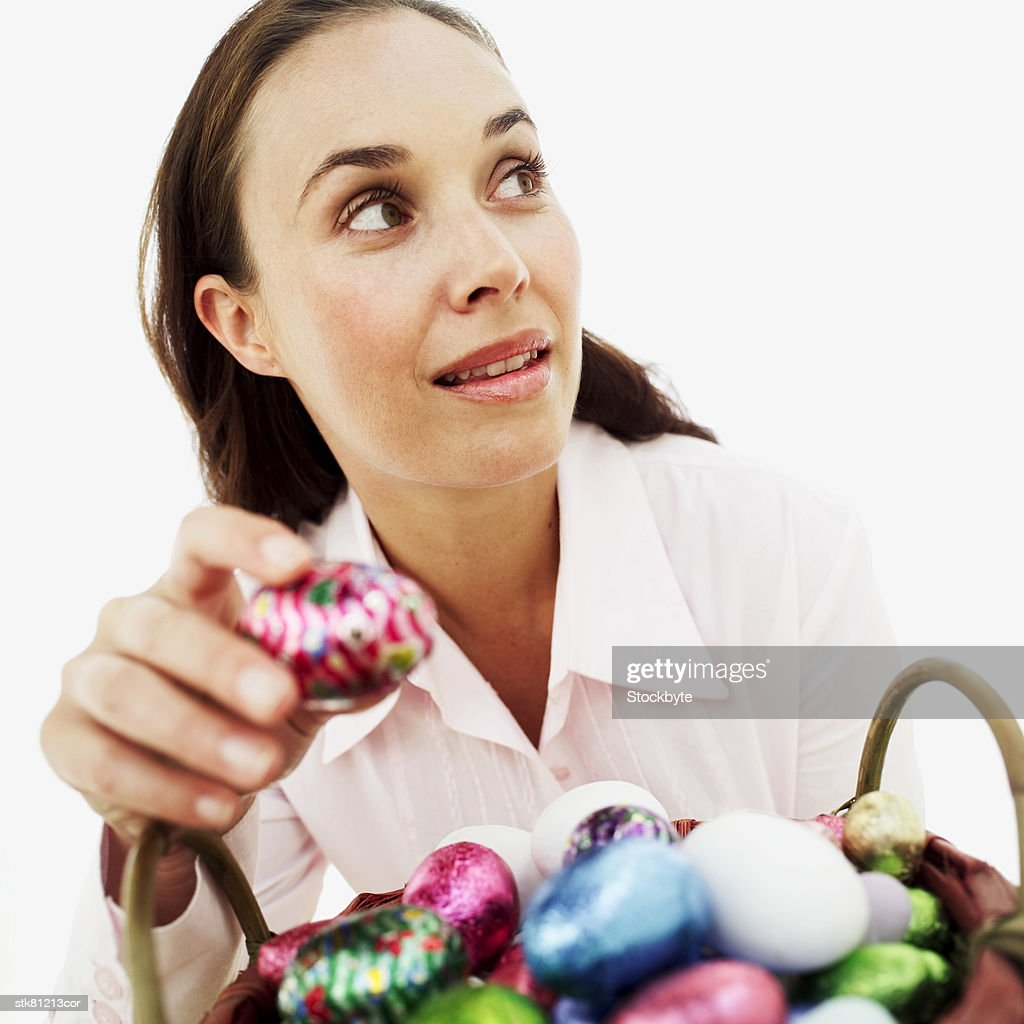 woman stealing an Easter egg : Stock Photo