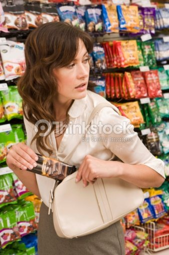 Woman Stealing Food Stock Photo | Thinkstock