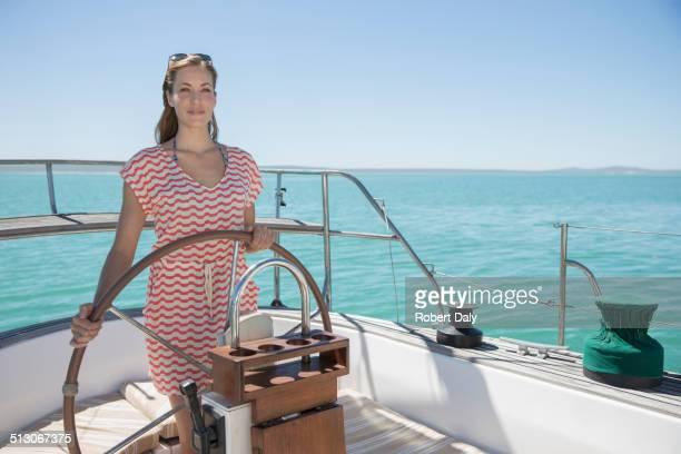 Woman steering boat on water