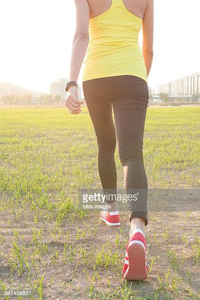 Woman stepping into pitch