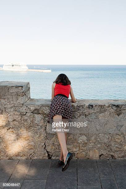 Woman sticking head out of breakwater