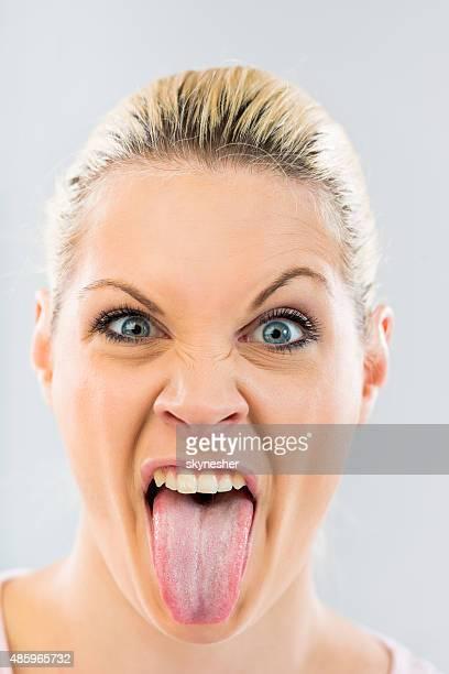 Woman 舌を出すとカメラ目線ます。